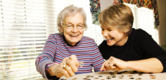 a caretaker playing together with her patient